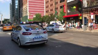 2 NYPD CRUISERS RESPONDING ON 8TH AVENUE IN THE MIDTOWN AREA OF MANHATTAN IN NEW YORK CITY.