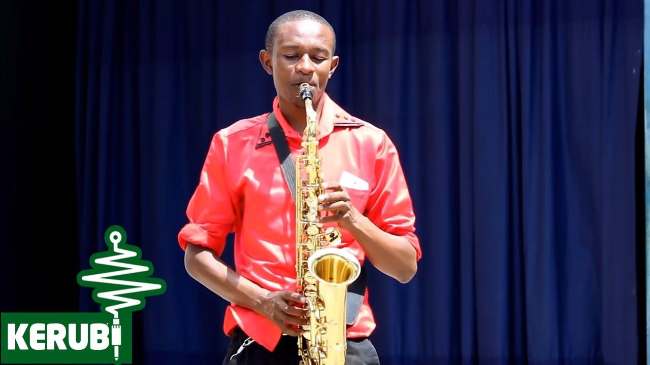 Download Mt. Kizito Makuburi - Wewe ni Mungu (Official Music Video)