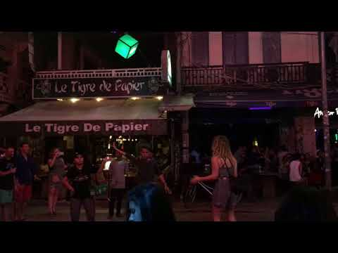 beautiful street food vendor dance with foreigners Pub street Siem Reap Cambodia