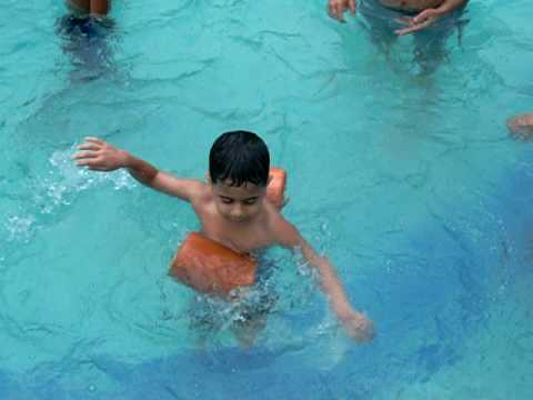 child shivering but still swimming - YouTube
