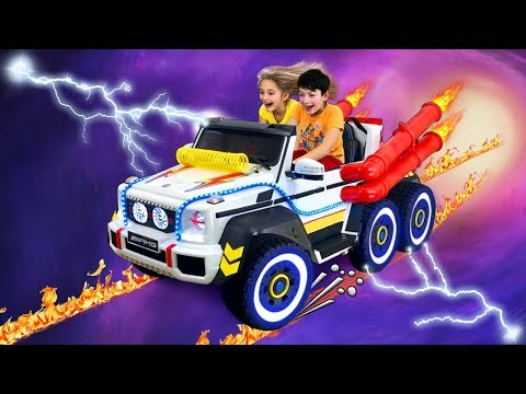 Sasha ride on Time Machine and play with Dinosaurs and Robots