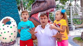 Download Diana and Roma walk in the Dinosaur park & Museum of Illusions Mp3 and Videos