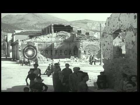 People return after Allied bombings in Palermo, Sicily, Italy during World War II...HD Stock Footage