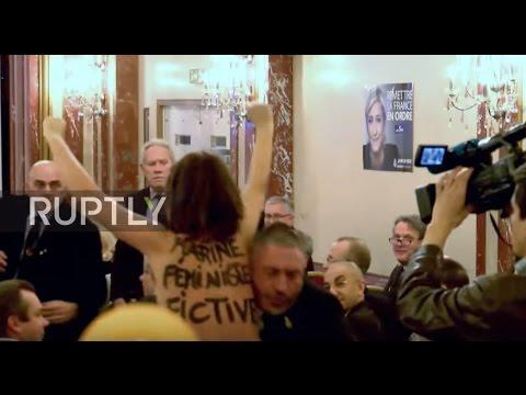 France: FEMEN vs Le Pen! Topless protester upends National Front press conference