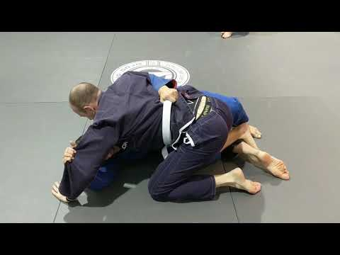 Half guard to mount transition