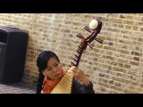 Chinese Musical Instruments - The Pipa or Lute played by street performer