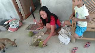 FILIPINA WIFE DRINKING BUKO IN THE PHILIPPINES EXPAT SIMPLE LIFESTYLE PHILIPPINES