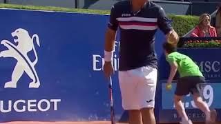 Tennis ball boy hits his head in the wall