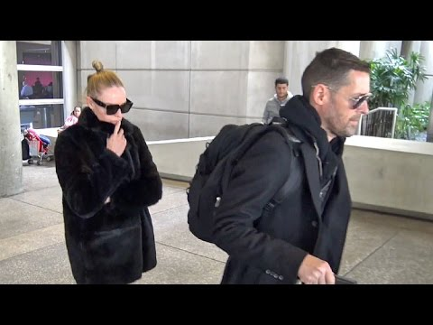 Kate Bosworth And Michael Polish Arrive Home From Berlin Fashion Week
