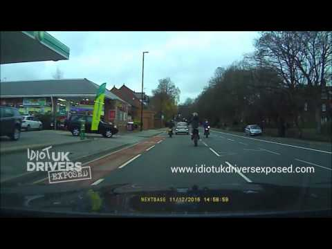 Caught on dash cam. Dangerous Young Moped rider attempts wheelie and fails. Otley Road, Leeds
