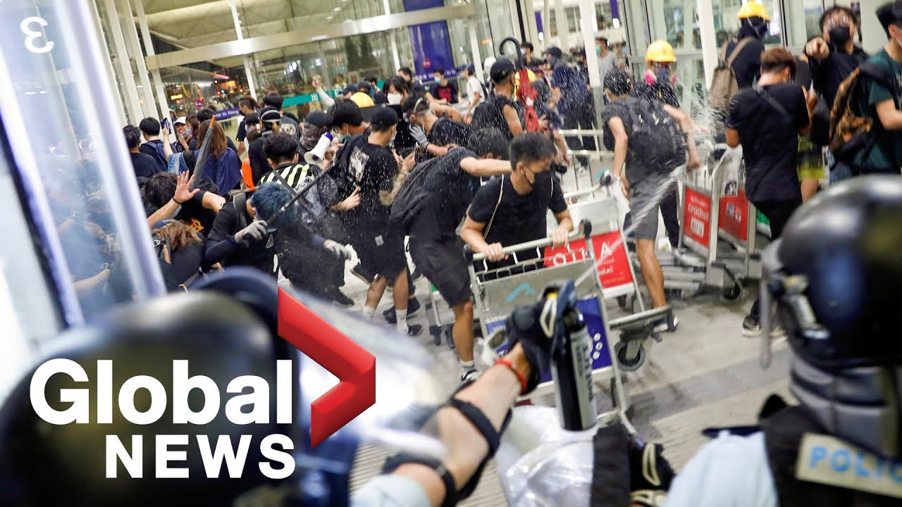 Hong Kong police clash with protesters at airport