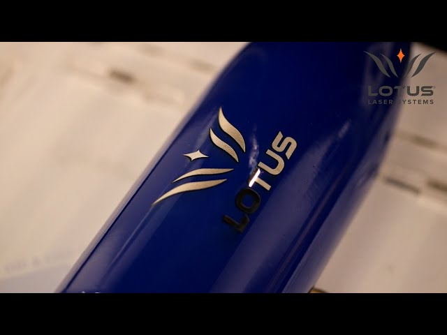 Lotus Laser Systems uMeta fiber laser engraving a painted thermal bottle