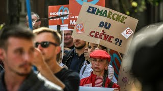 Hardliners protest French labour reform as Macron chides