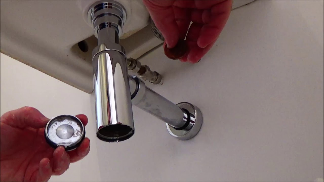 cleaning your basin bottle trap