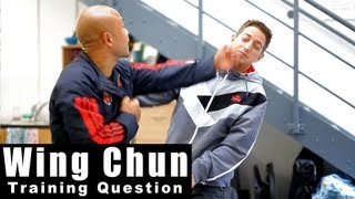Wing Chun Training - Wing Chun how to deal with a hook. Q5