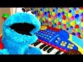 Cookie Monster Plays Piano -- stay for a FUN ending when Cookie Monster sings with the piano!