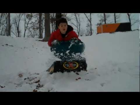 Family laughter with snow, sleds and a ramp