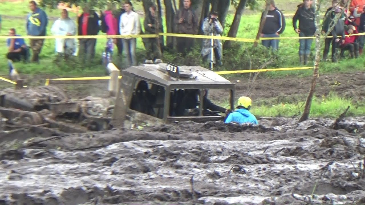 4x4 Off-Road Trucks mudding in big mud puddle