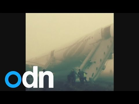 WATCH: Passengers use emergency slide after plane overshoots runway