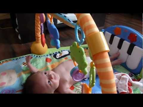 Sj playing/cooing on music play mat