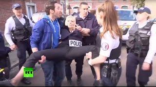 Полиция задержала активисток FEMEN рядом с участком, где голосовала Ле Пен