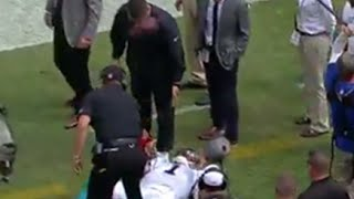 Panther's QB Newton SMACKS Man in Face with Ball while Laying on Sideline vs Vikings