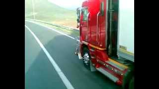 Engine sound with loud jake brake coming down a pass in a Freightliner Argosy