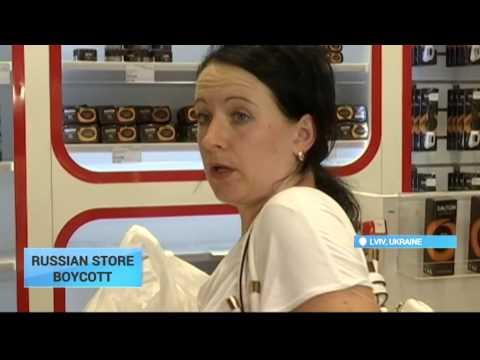 Russian Business Boycott: Lviv activists drape toilet paper with Putin's face across store