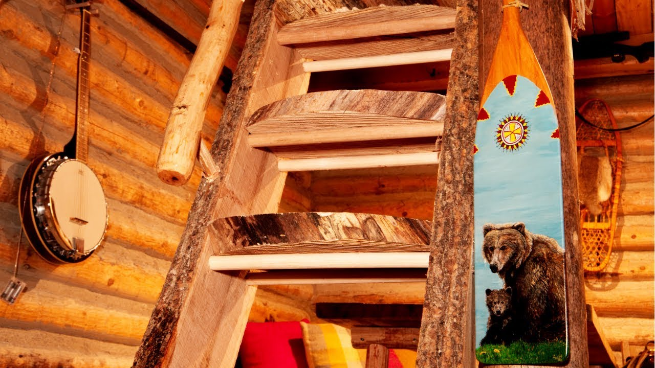 live-edge-wood-staircase-in-a-rustic-log-cabin-working-alone