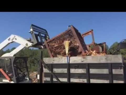 Bobcat a 300 dumping baskets of firewood