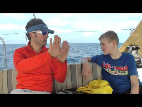 Bill Springer of Swizzle Media explains the fundamentals of sailing to a young Will Fenn