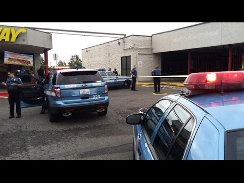 Bank security guard shot in Seattle, July 24, 2014