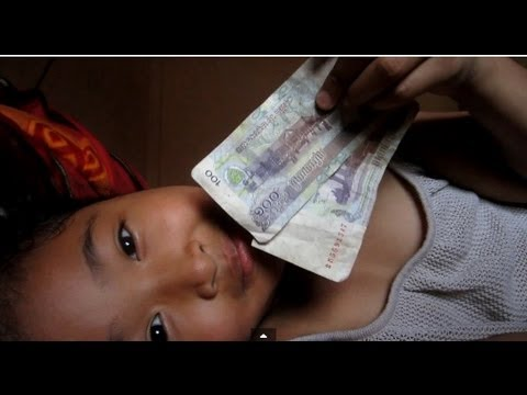 Feed Pig With Cambodian Riel Money!