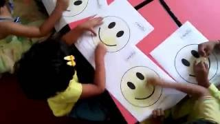 Childhood - PlayGroup students colouring on Yellow Colour Day
