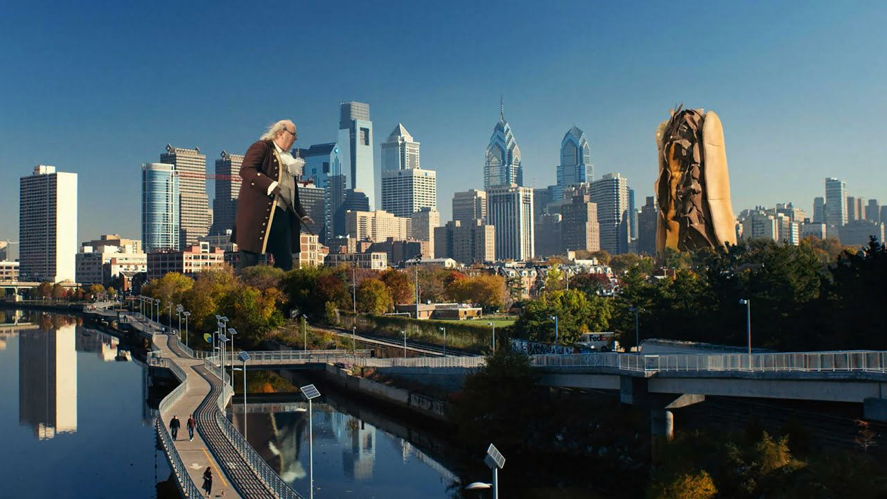 Watch giant ben franklin fights a cheesesteak in the for Places to visit philadelphia