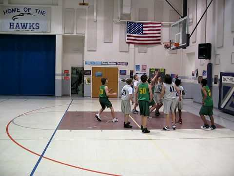 Alex scoring a basket against Southwest Middle School.