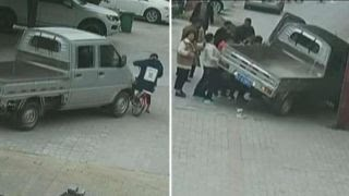 Watch hero pedestrians lift truck off trapped girl