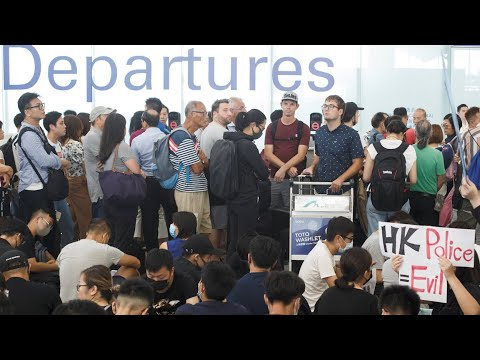 Watch live: Protesters bring Hong Kong airport to standstill after clashes