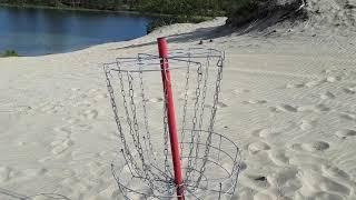 Frisbee op het strand