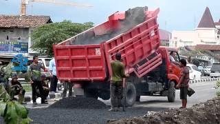 Dump Truck Unloading hot Asphalt Gravel