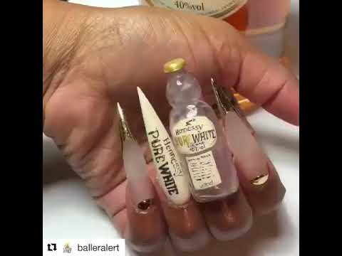 Women's Hennessy Nails filled with real Henny
