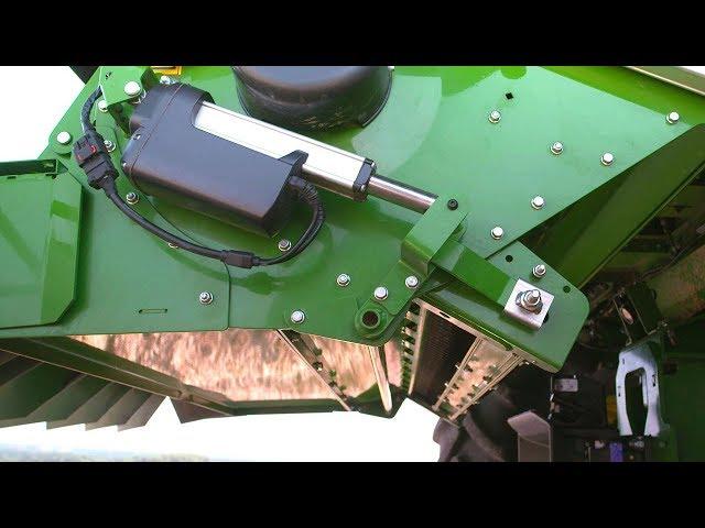 John Deere - Ajustement à distance de la barre de coupe