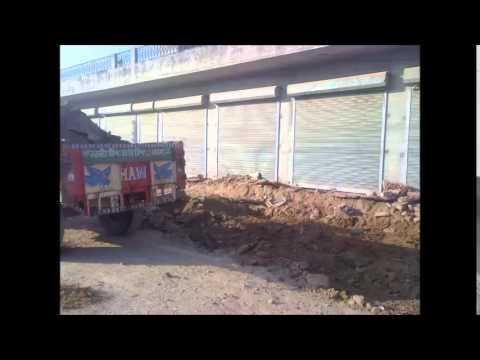 Illegal demolition of shop's veranda by Ashok kumar bangi and his crew