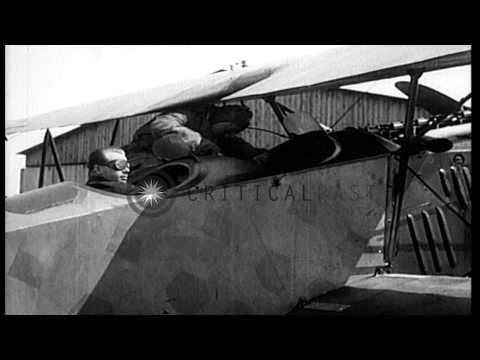German World War 1 ace, Ernst Udet, gives passengers rides in a German Fokker D.V.HD Stock Footage