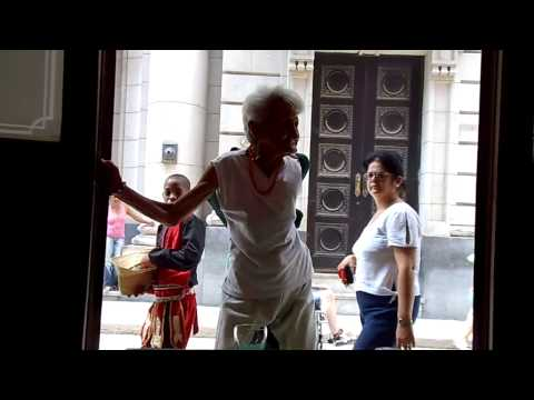 80 Year old Cuban Woman dancing Salsa in the streets of Havana