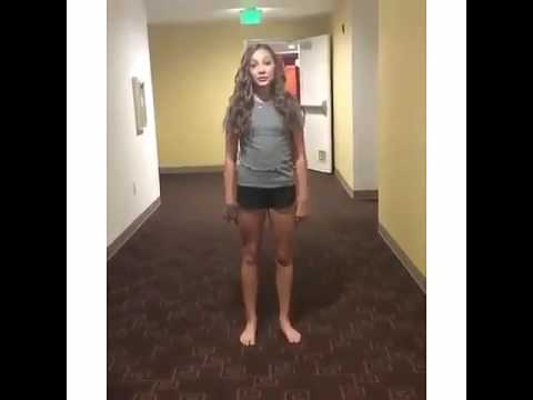 Maddie Ziegler doing the 22 pushup challenge