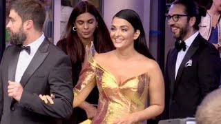 EXCLUSIVE : Gorgeous Aishwarya Rai with an amazing golden dress comes out of the Palais backdoor ent