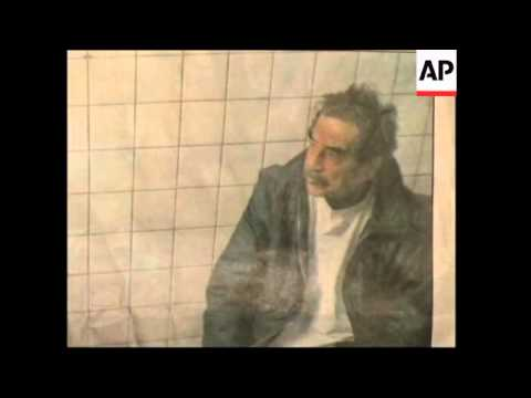 Newspaper photographs of Chalabi with Saddam in prison