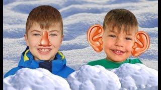 Ринат и Ричард играют со снегом и лепят снеговика