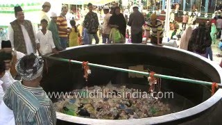 Throwing money and food into Badi Deg at Ajmer Sharif